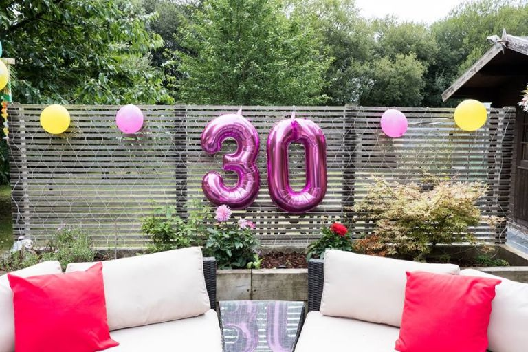 30th garden party with yellow and pink tropical theme