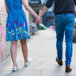 Close up of couple holding hands in Shoreditch