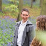 Groom to be smiling at bride in Harpenden woods