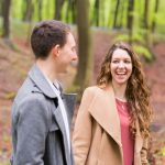 Couple laughing in autumnal woods