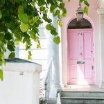 Pastel pink front door with white steps in Notting Hill