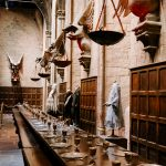 Wide shot of the Great Hall at Hogwarts laid out for banquet