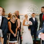 Bride walking down the aisle with her brother at Master Builder's venue
