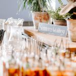 Row of Pimms with straws next to a wedding sign
