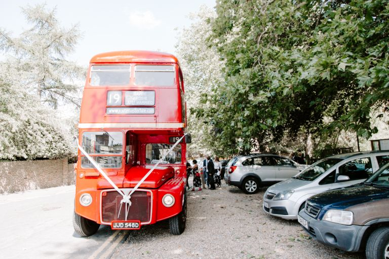Routemaster bus picking up wedding guest