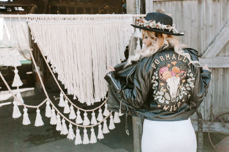 Bohemian bride wearing a handmade leather jacket