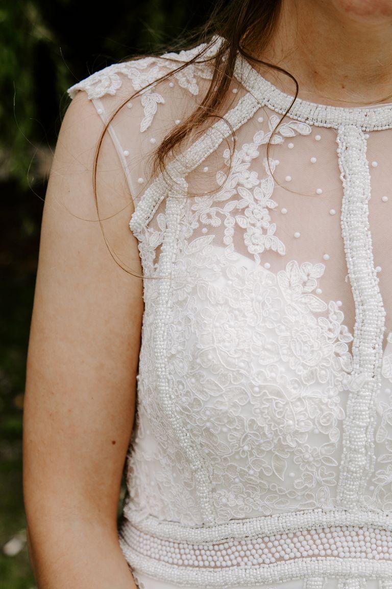 Boho bride wearing a beaded white dress