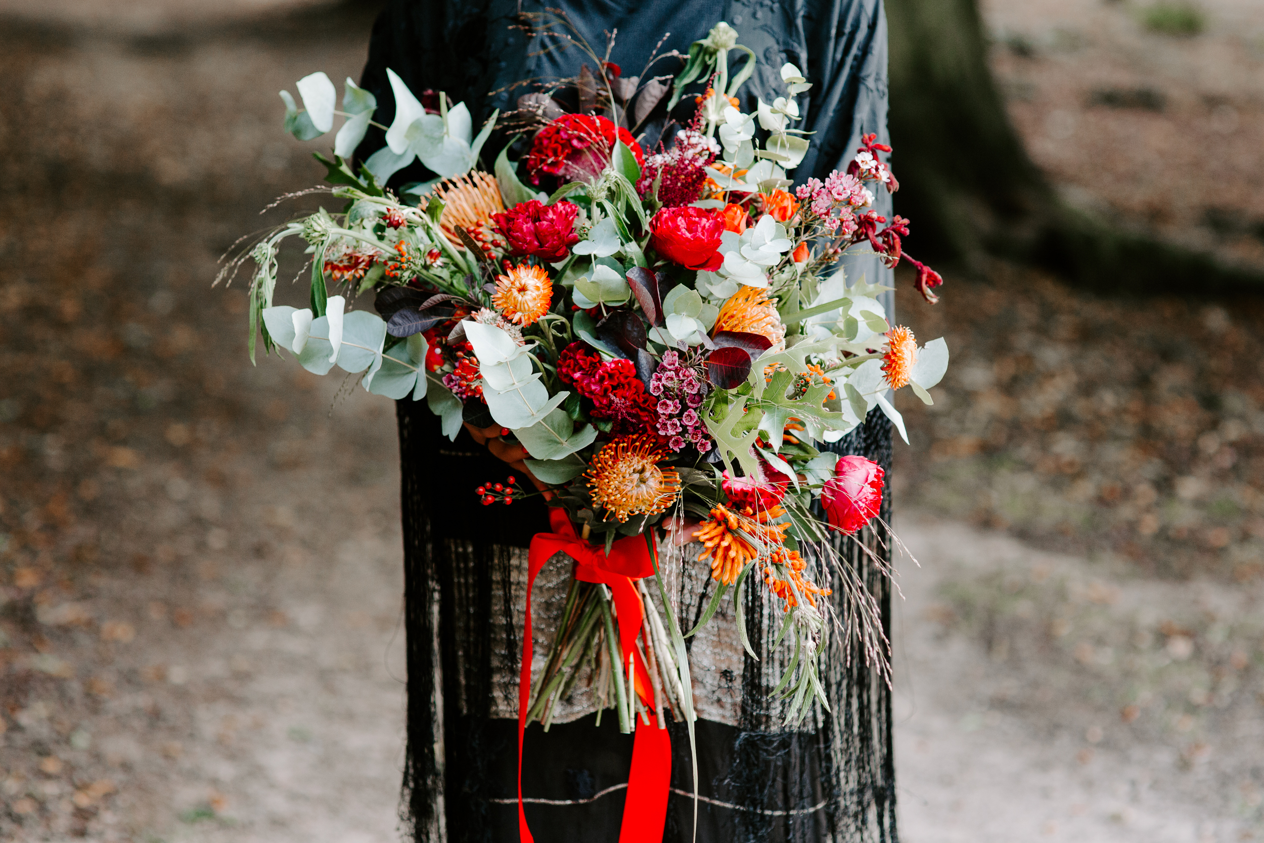 London autumn wedding bouquet with red ribbon