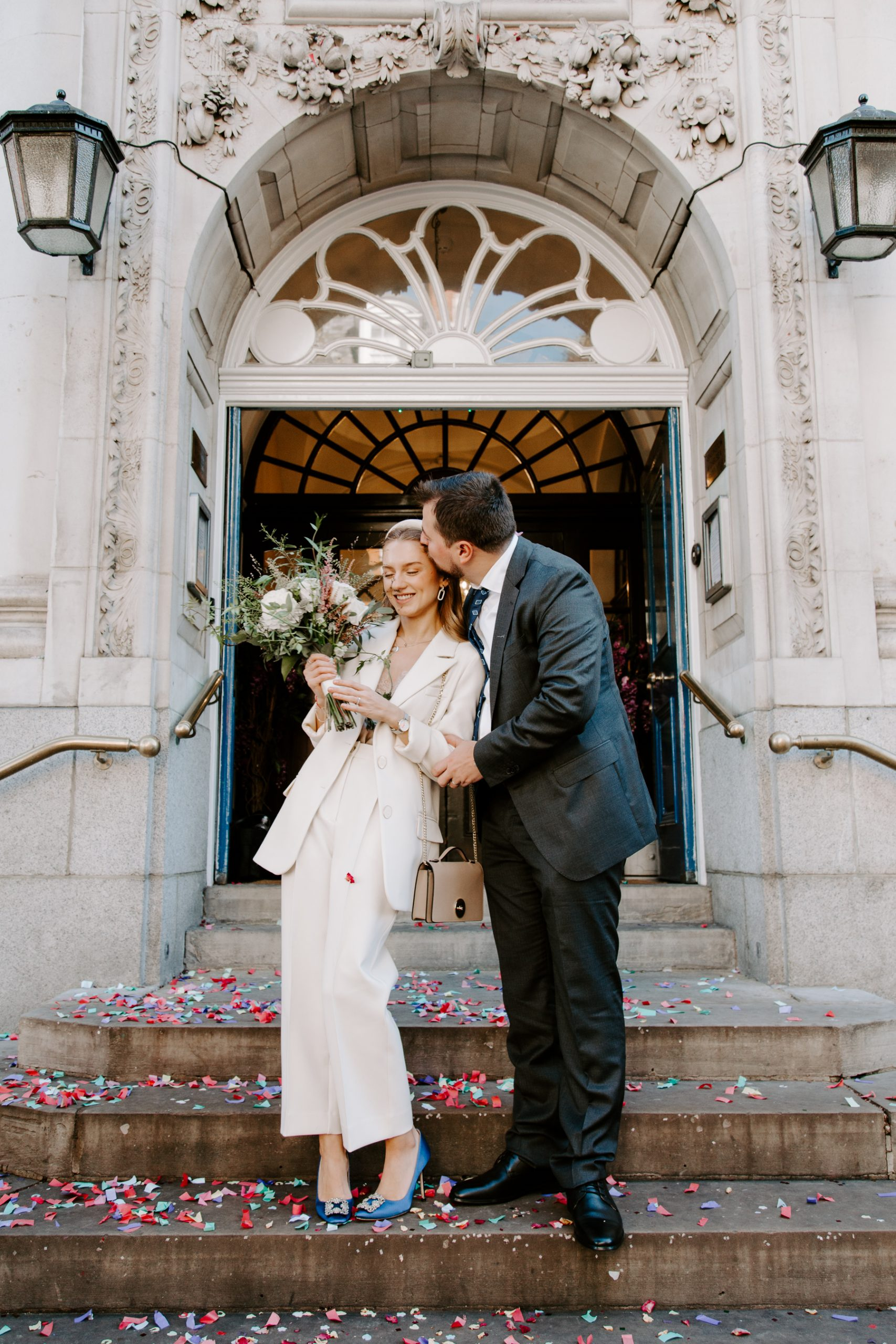 Modern Bride and groom on steps of Chelsea Town Hall