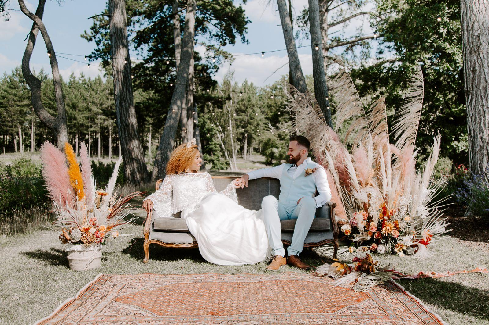 Couple on sofa at Brook Farm Cuffley tipi wedding