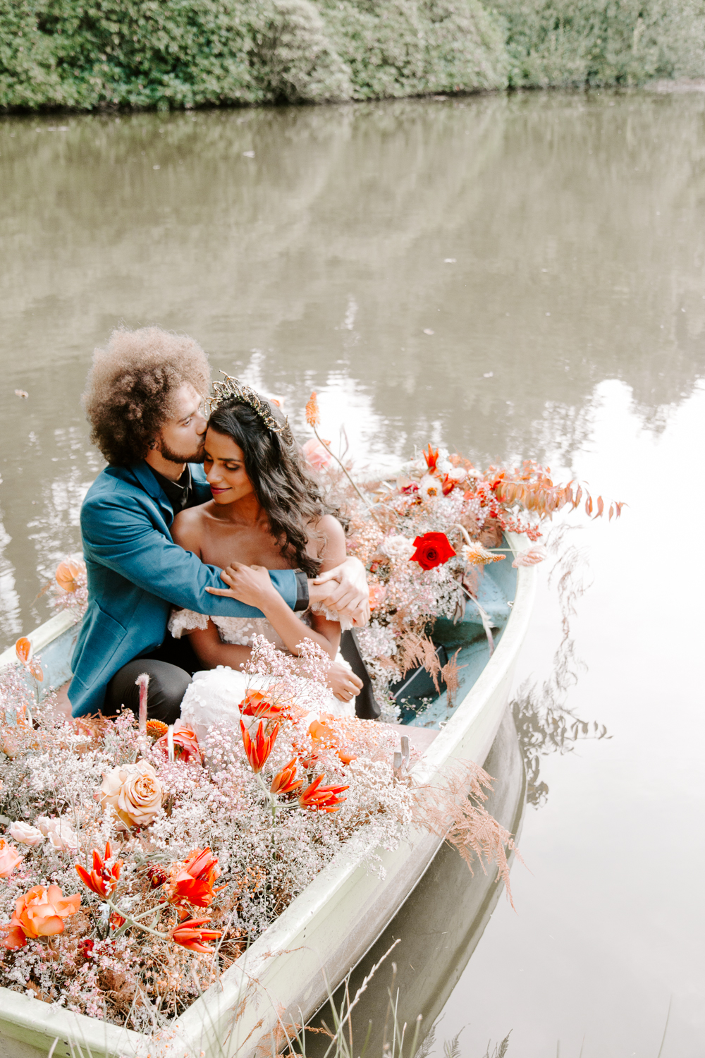 Bride and groom in boat at Shropshire wedding
