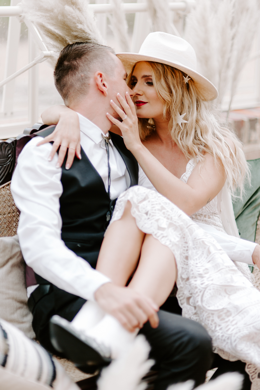 Alternative bride and groom at UK glasshouse wedding venue