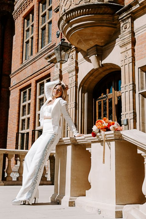 Bride wearing a suit at Woldingham School Wedding Venue in Surrey
