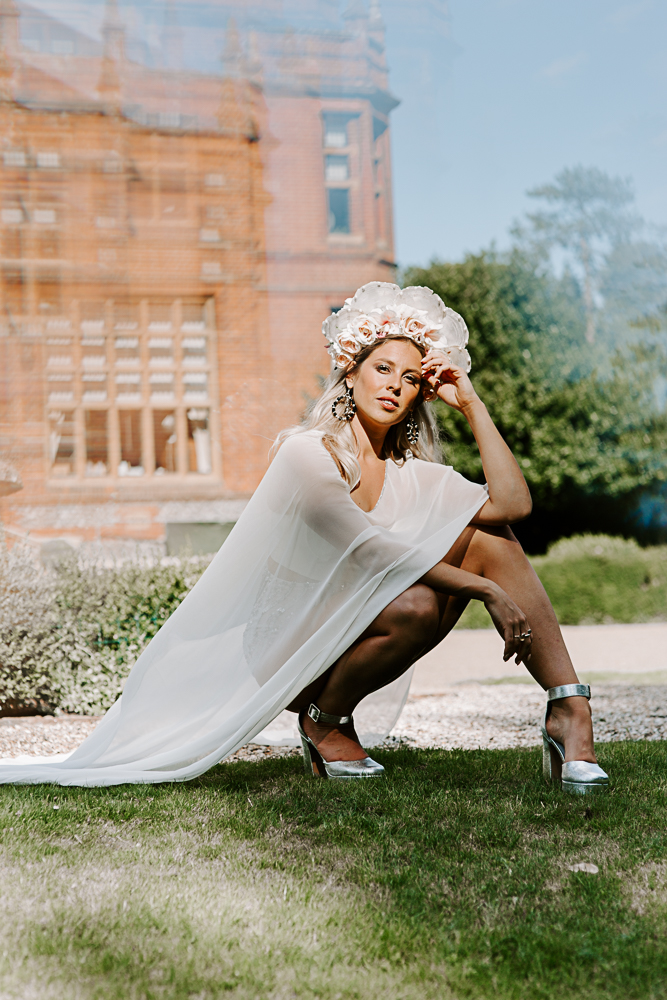 Bride in cape and headdress at Surrey wedding