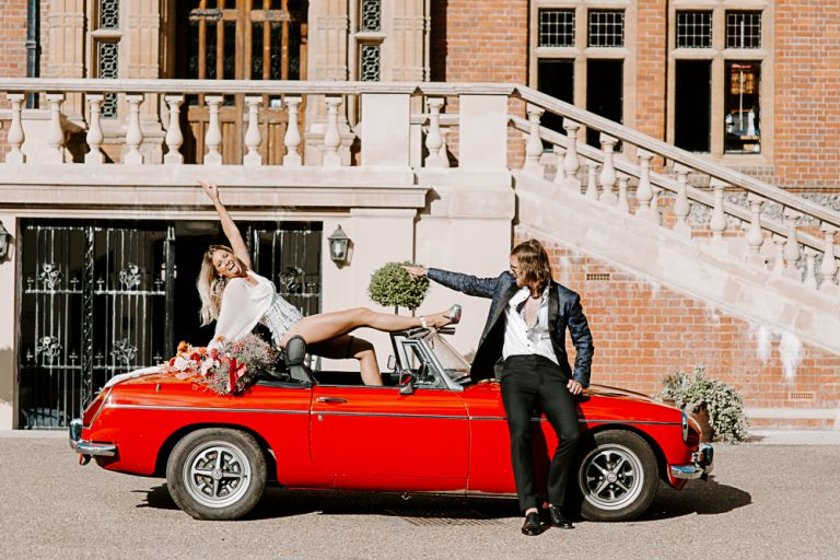 Bride and groom with vintage wedding car at Woldingham School
