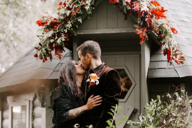 Couple kissing at Upthorpe Wood wedding venue